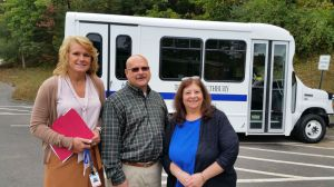 Southbury officials pose in front of new mini-bus
